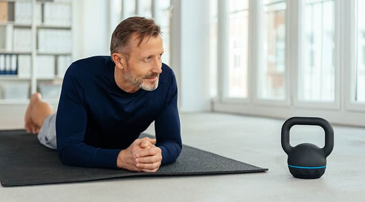 Man on yoga mat working out with improved testosterone