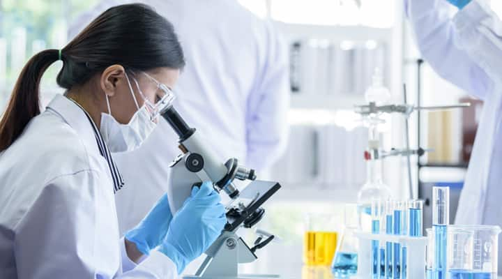 Woman lab tech studying the benefits of tocotrienols