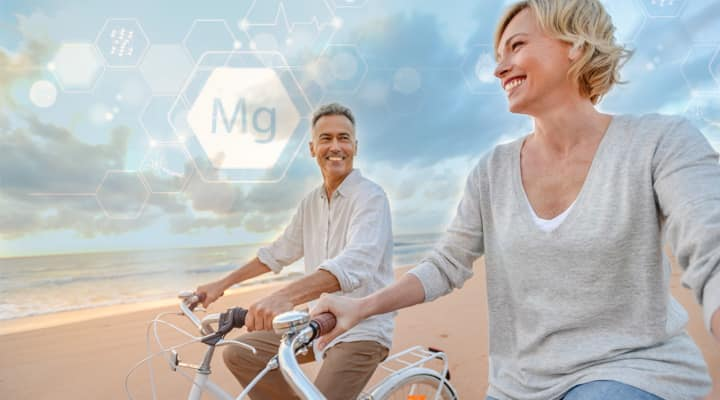 Couple biking on beach supplementing with magnesium for insulin sensitivity