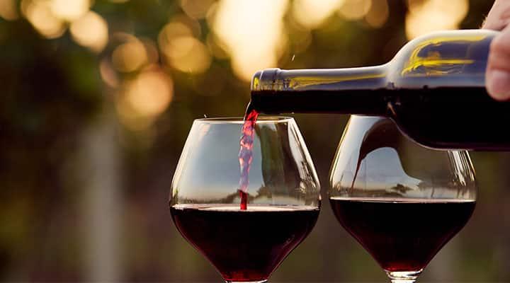 Red wine being poured apart of the Mediterranean diet