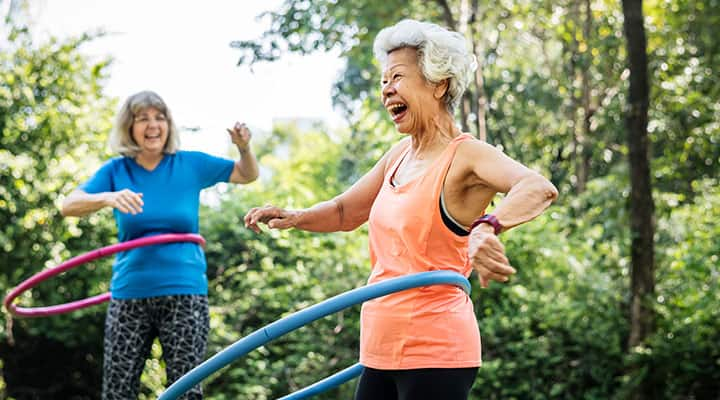 Older woman hula-hooping with resveratrol support