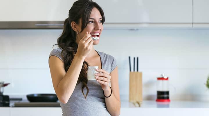 Woman enjoying probiotic-rich yougurt