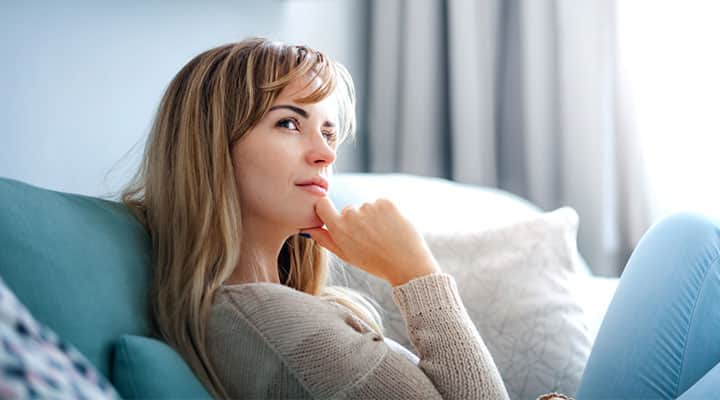 Woman thinking on adaptogens and their side effects
