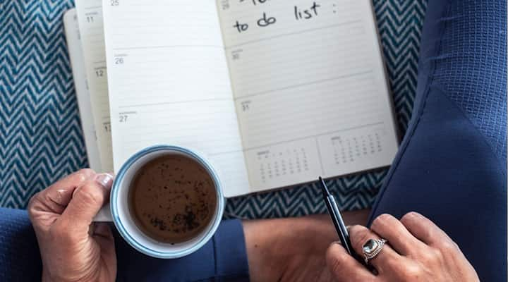 Woman starting her day early and prioritizing tasks