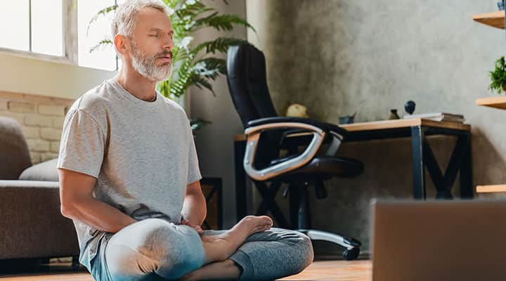 Man maintaining cortisol levels by meditating