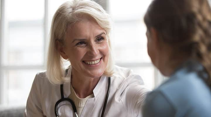 Woman speaking with her doctor before taking L-theanine