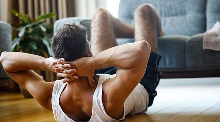 Man doing crunches to firm up abs