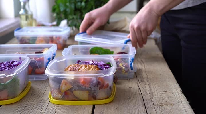 Man packing pre-made healthy meals at home