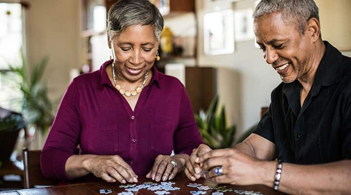 Elderly couple completing puzzel with boost from lithium