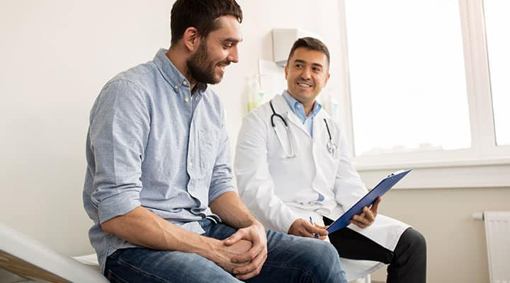 Man speaking with his doctor about his liver health
