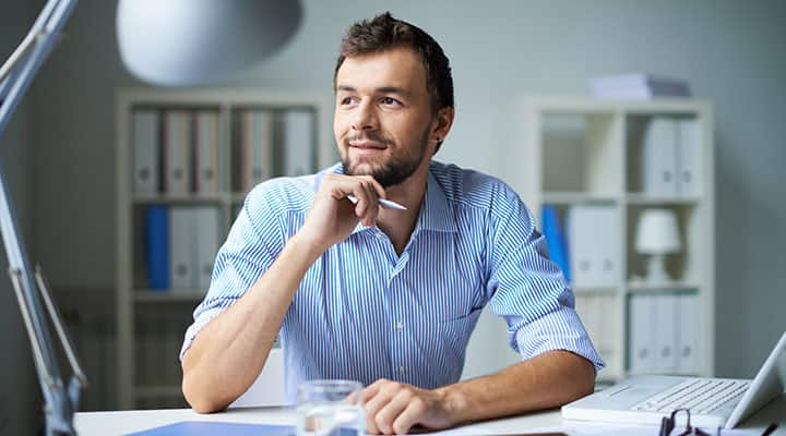 Man sitting at desk thinking about improved memory