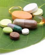 vitamins, tablets, pill and green leaf