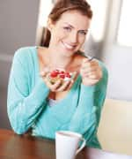 Woman eating bowl of yogurt
