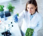 A scientist looking at vegetables