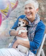 Woman holding dog who's boosting immune system