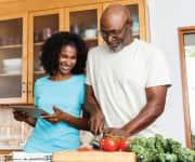 Older couple preparing dinner together