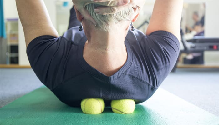 woman practicing self-massage